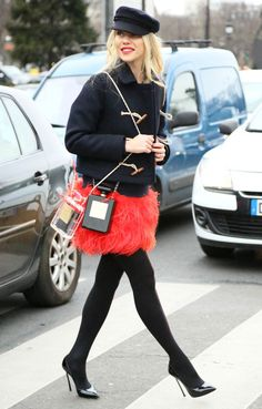 Chanel perfume bottle bags, feather skirt, and toggle jacket.