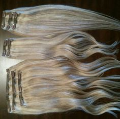 """20"""" Blonde Cashmere Hair Extensions 20"""" inches, 200 Grams Sunset Blonde 18 & 22 clip in extensions 100% Remy hair They've only been worn a handful of times. Never been washed. Super soft and very pretty! Hanger and travel zip case included! Only selling, no trades :) Cashmere Accessories Hair Accessories"""
