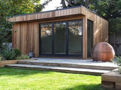 Cedar summerhouse in Barnet with Grey Bi-fold doors
