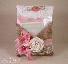 Great idea to make ta burlp gift Pocket/envelope- looks easy to make with some burlap, hot glue, ribbon and a few other trinkets to embellish.