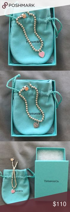 "Authentic return to Tiffany bead bracelet Authentic and purchased directly from Tiffany's, comes with dustbag and box. Worn twice and in excellent condition, small size, pink enamel and sterling silver bead bracelet. Official name is ""return to Tiffany bead bracelet in silver with pink enamel finish"". Tiffany & Co. Jewelry Bracelets"