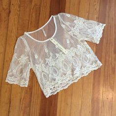 Lace Crop Top Overlay Super cute lace detailing. Very pretty. Retails for $50. Cute length. Perfect for the summer. Has a little stretch to it. Fits a S, more comfortably. PacSun Tops Crop Tops