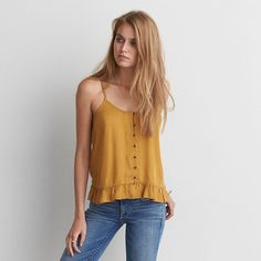 AE Ruffle Hem Cami Mustard ($30) ❤ liked on Polyvore featuring tops, yellow, cami tank, crop tank, cami crop top, yellow crop top and cropped cami