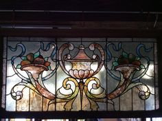 Rudy Bros. Antique cornucopia and urn stained glass window
