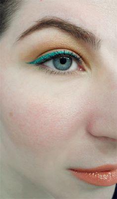orange eyeshadow coral lipgloss lip tar emerald green liquid eyeliner makeup