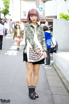Shizuku is a 19-year-old college student with a cute lilac bob hairstyle who we met in #Harajuku. Her look includes a camouflage shirt (somewhat trendy right now) with an American Apparel tote bag and loafers. #tokyofashion #street snaps