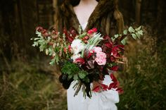 Fall bouquet with leaves, berries and garden roses