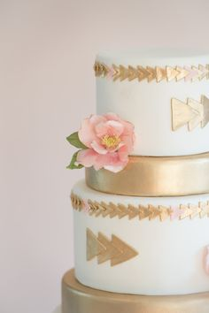 white wedding cake with gold arrows and pink roses by erica obrien cake design hamden ct