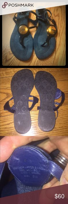 Tory Burch navy patent flat sandals w/gold details Very lightly worn Tory Burch flat sandals. Stunning gold details - logo medallion on top of foot and gold around the heel of the shoe. Navy patent leather straps. Perfect summer shoe! Tory Burch Shoes Sandals