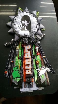 Nightmare before christmas themed garter! Custom lettering and handmade images to complete the overall look! Annies mums, find me on facebook! #homecoming #homecomingmum #homecominggarter #texashomecoming #texasfootball #nightmarebeforechristmas Homecoming Garter, Homecoming Mums, Football Mums, Homecoming Spirit Week, Mums The Word, Nightmare Before Christmas, Christmas Themes, Party Planning, Baby Shower