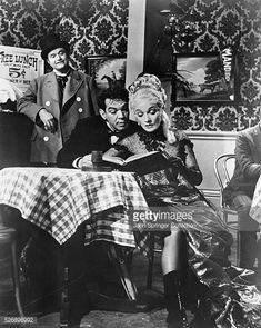 Red Skelton as a drunk in a saloon watching Passepartout and the saloon hostess in the 1956 production of Around the World in 80 Days