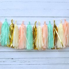 Peach, mint, gold and ivory...this wispy shabby chic garland will be a gorgeous touch to your party decor. Use this perfectly pretty decoration for your event and once the guests leave it will look lo