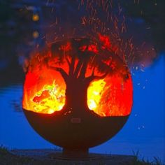 Tree of Life Fire Pit Sphere. Tree tops encircle this round earth shaped fire pit sphere reminding us of the beauty and importance of trees to our planet. Rustic Fire Pits, Metal Fire Pit, Diy Fire Pit, Fire Pit Backyard, Fire Pit Sphere, Fire Pit Gallery, Fire Pit Essentials, Custom Fire Pit, Large Fire Pit