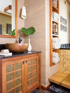 Copper vessel sink - Spa Style To achieve a Zen feel in this 5x9-foot master bath, this vanity features earthy, natural colors and materials. The small custom vanity is topped with black granite, a hammered-copper sink, and a fountainlike faucet. The vanity doors feature an Asian-inspired shoji screen pattern, but the recessed portions are filled with copper, instead of paper, to match the sink. Natural color variations of all the materials emphasize the room's earthy appeal.