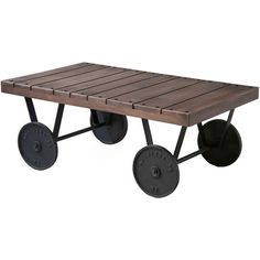 Hand-painted wood coffee table with industrial-style wheels.   Product: Coffee tableConstruction Material: Solid ...