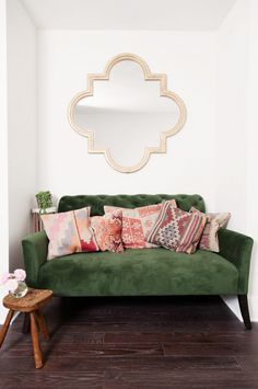 Green sofa with a mix of pillows