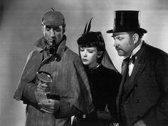 Basil Rathbone, Ida Lupino and Nigel Bruce in Adventures of Sherlock Holmes.