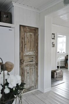 Love the white board floor and shabby old door1