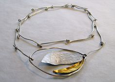 Nicole Gauvin: Collier (2013) /  Silver .925, oxidation, patina, melting and Applying gold leaf
