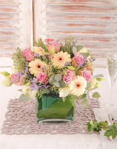 Spring wedding pastel flower arrangement for reception table centerpiece