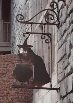 I'm looking for the Harry Potter Leaky Cauldron hanging sign that came out in There's no writing on the metal sign, just a witch stirring a cauldron. Witch Cottage, Witch House, Vintage Halloween, Fall Halloween, Halloween Witches, Vintage Witch, Happy Halloween, Wiccan, Witchcraft