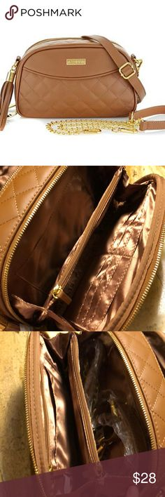 Joy & Iman leather purse JOY & IMAN Diamond Quilted Genuine Leather Crossbody with RFID  NWT Fashion and function come together in a stylish, safe and smart accessory you can take anywhere. This compact genuine leather crossbody, designed with one exterior and 23 interior pockets, eliminates your need to carry a wallet or cosmetic bag. Easy-access openings put everything right at your fingertips, while the main body's RFID protection safeguards your personal information. Two interchangeable…