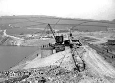 0501 This is work on the embankment for Digley Reservoir so this is likely to be the early 1950s. Digley Cottages can be seen in the background.