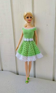 Best 11 Crochet Dolls Design Handmade dress for Barbie doll by my own design. Crocheted dress made of light green cotton yarn in combination with a white cotton yarn. Fastened at the back by two snap buttons. Doll and shoes is NOT included. Crochet Bodycon Dresses, Crochet Doll Dress, Crochet Barbie Clothes, Doll Clothes Barbie, Knitted Dolls, Barbie Doll, Knitted Baby, Barbie Clothes Patterns, Clothing Patterns