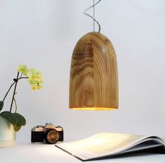 Wooden Hanging Ceiling Shade with braided grey silk cable. Solid ash. This solid ash pendant lampshade is hand turned with beautiful natural wood