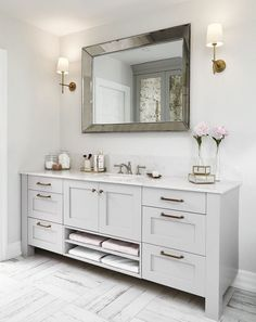 Design Tip: For a calming bathroom retreat, go for grey. Square Footageinc shows us how it's done, complementing the neutral hue with a Statuario Maximus vanity and just the right amount of brass accents. Bathroom Renos, Grey Bathrooms, Beautiful Bathrooms, Bathroom Interior, Cottage Bathrooms, Bathroom Remodelling, Bathroom Vanity Tray, Vanity Sink, Bathroom Cabinets