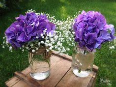 Rustic Mason Jar Centerpieces designed with Purple Hydrangea, finished with Baby's Breath                                                                                                                                                      More
