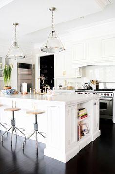 Black floors in a white kitchen