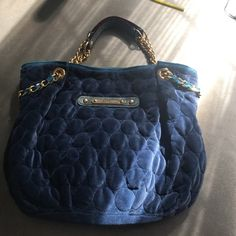Juicy couture bag Navy blue juicy couture Velour bag has gold chains and it is in great shape. Selling this bag because it's never used anymore and needs a nice home. Juicy Couture Bags