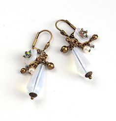 Czech Opal glass earrings, ooak, Victorian/Shabby Chic genres, with Swarovski crystal pearls and AB crystals clustered along side Czech white opal glass buttercups. Exquisite for a vintage wedding, or any ethereal occasion.   Length: 1-1/4 inch (3.2 cm)