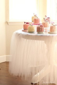 Dress up your table with a pretty tulle tablecloth! Get the DIY from Girl. Inspired.  http://thegirlinspired.com/2012/10/tutu-tablecloth-tutorial/