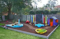 Play area for kids... I'd like to have an area like this for Kellie in our yard- maybe with a really small picket fence around it and a play house/water & sand table/balance beam/stepping stones/chalkboard