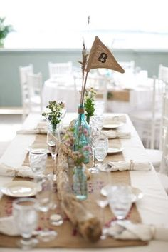 """rustic  tablescape.  love the blue glass with burlap banner!  Would look cute with a """"2"""" """"0"""" """"1"""" """"3"""" for Graduation!"""