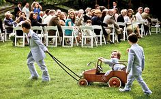A wagon for the littlest ring bearer! So. Friggin. Adorbs. Photo by JAG Studios.