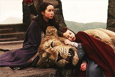 Lucy and Susan with Aslan on the Stone Table