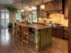 French Country Kitchen Style Chairs Royal Cabinets  A little too dark for my taste overall, but I like the bar, & I LOVE the hanging lanterns!