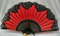 This fan is made of black hand carved wood painted with gold accents. Red fabric trimmed with quality black lace. Great for dancing, decorating, center piece, gift….