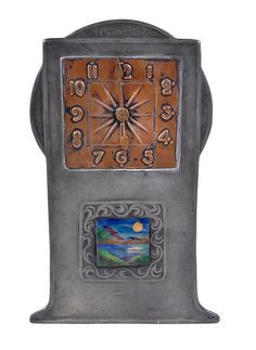 A Tudric pewter, copper and enamel clock by
