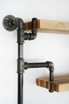 Industrial three level shelving unit with butcher block style assorted wood shelves. Wood is former floorboard samples. Whether you are looking for a piece that stands out in your home, or looking to… Diy Pipe Shelves, Industrial Pipe Shelves, Industrial House, Wood Shelves, Hanging Shelves, Industrial Style, Black Pipe Shelving, Vintage Furniture Design, Industrial Design Furniture