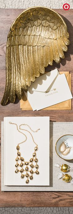 It's throw-a-party season—a gold winged dish and a sparkly statement necklace will add instant glam to any holiday festivity.