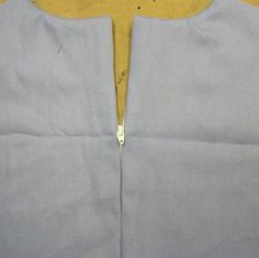 Centered zipper construction, different than the home sewing version
