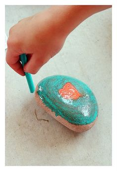 You heat up the rocks then color w/ crayons, which melt when they touch the hot rocks! So cool!