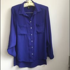 Royal Blue Shirt Gorgeous royal blue color. Hi low hem, roll up sleeves. Excellent used condition. H&M Tops Button Down Shirts