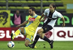 Gonzalo Higuain of SSC Napoli competes for the ball with Gabriel Alejandro Paletta of Parma FC during the Serie A match between Parma FC and...