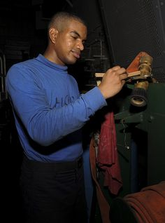GULF OF OMAN (June 19, 2013) Aviation Boatswain's Mate (Handling) Airman Apprentice Jociah Starks, of Atlanta, performs maintenance on an Aqueous Film Forming Foam (AFFF) station in the hangar bay on board aircraft carrier USS Nimitz (CVN 68). Nimitz Strike Group is deployed to the U.S. 5th Fleet area of responsibility conducting maritime security operations, theater security cooperation efforts and support missions for Operation Enduring Freedom.