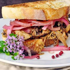 Apple Braised Pulled Chicken Sandwiches with Pink Peppercorn Pickled Red Onions